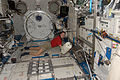 ISS-24 Shannon Walker during housekeeping.jpg