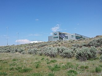 Idaho Falls, Idaho - The Idaho National Laboratory, the University of Idaho, Idaho State University, Boise State University, and the University of Wyoming have labs, classrooms, offices, and other facilities just north of downtown. Among these partnerships is the Center for Advanced Energy Studies (CAES), shown here, which overlooks the Snake River.