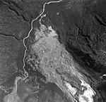 Iliamna Glacier, terminus of valley glacier mostly turned into a rock glacier, trimline along valley walls, and braided streams (GLACIERS 6580).jpg
