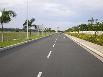 Iloilo International Airport - A secondary access road leading to the airport complex. This road branches from the main access road leading to the airport.