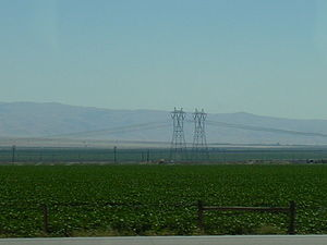Path 26 - The two western Southern California Edison power lines in the southern San Joaquin Valley of California. Taken on  Interstate 5, looking southwest at the semiarid foothills of the Pacific Coast Ranges.