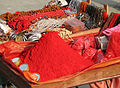 India - Haridwar - 007 - Red tikka powder & jewelry (2085726831).jpg