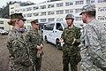 JGSDF Col. Hisanori Fukada speaks with U.S. Marine Corps 2nd Lt. Brea Hapken in Ishinomaki, -31 Mar. 2011 a.jpg