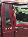 Jeep Comanche 4.0L High Output six 4x4 long-bed burgundy with white cargo cap 3of3.jpg