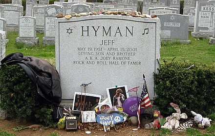 Headstone for Joey Ramone with fan tributes Joey Ramone Headstone.jpg