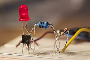 2N3904 - A 2N3904 in a TO-92 package on a breadboard (lower left)