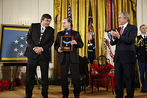 Woodrow W. Keeble - Keeble's stepson Russell Hawkins (center) accepts the Medal of Honor from President Bush on March 3, 2008