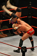 http://upload.wikimedia.org/wikipedia/commons/thumb/5/57/Kennedy-bodyslams-Holly,-RLA-Melb-10.11.2007.jpg/150px-Kennedy-bodyslams-Holly,-RLA-Melb-10.11.2007.jpg