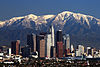 Los Angeles skyline with San Gabriel mountains in background.