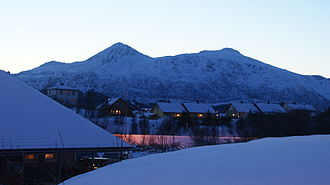 Leknes - View of Leknes in winter (Bulitinden and Guratinden mountains in background)