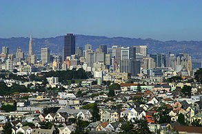 The downtown San Francisco skyline, looking east from the central part of the city.  The hills in the background are across the bay in Berkeley.
