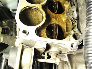Inlet manifold - Lower intake manifold on a 1999 Mazda Miata engine, showing components of a variable length intake system.