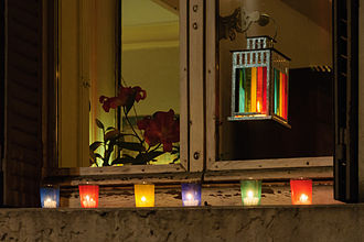 Festival of Lights (Lyon) - Candle lights on a windowsill on December 8.
