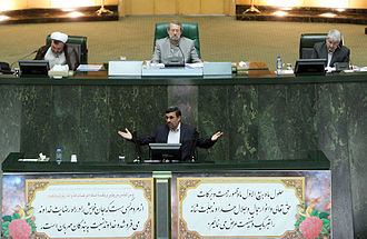 Mahmoud Ahmadinejad - Ahmadinejad speaking in the Majlis, Chairman Ali Larijani is also pictured