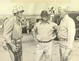 Sands of Iwo Jima - General Graves B. Erskine (right) and John Wayne (left) on the set. Erskine was a technical advisor for the film.