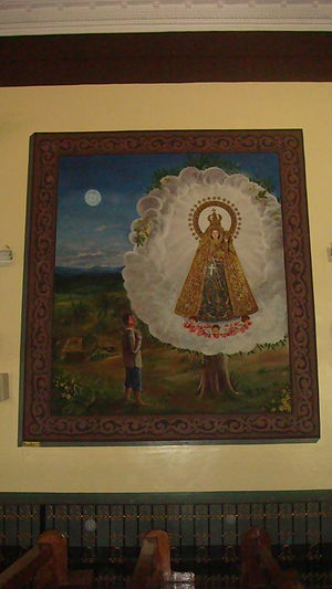 Our Lady of Manaoag - The Virgin's appearance to the farmer, depicted on a mural in the transept.