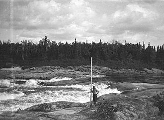 Manicouagan River - Surveying the Manicouagan River at the first falls, 1919