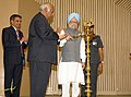 Manmohan Singh lighting the lamp at the presentation ceremony of the Prime Minister's Shram Awards for the years 2008, 2009 and 2010, in New Delhi. The Union Minister for Labour and Employment.jpg