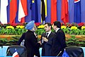 Manmohan Singh with the President of France Mr. Nicolas Sarkozy, and President of European Commission, Jose Manuel Barroso, at the concluding ceremony of the 7th ASEM Summit, at the Great Hall of the China, in Beijing, China.jpg