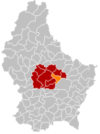 Map of Luxembourg with Fischbach highlighted in orange, the district in dark grey, and the canton in dark red