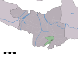 The village centre (dark green) and the statistical district (light green) of Zuiddorpe in the municipality of Terneuzen.