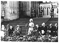 Margaret Thatcher speaking at the front a large English cathedral. Carl Albert and Parliament members are beside her. Magna Carta delegation.jpg