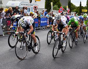 Sprinter (cycling) - A bunch sprint finish at the 2011 Tour de France, in which sprinter Mark Cavendish (in the green jersey) is being led out by the last of his team's sprint train, Mark Renshaw.