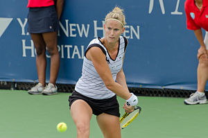 Mathilde Johansson - Mathilde Johansson returns a shot at the 2011 New Haven Open qualifying tournament