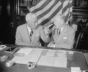High Commissioner to the Philippines - High Commissioner to the Philippines Paul V. McNutt (left) makes a point to Secretary of War Harry H. Woodring during an official visit to Washington in 1938.