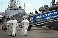 Members of the public pass the USS Mitscher during a ship visit at the Riverfront Pier in New Orleans in conjunction with The War of 1812 Bicentennial Commemoration..jpg