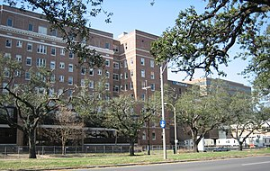 Ochsner Baptist Medical Center - The Medical Center seen from Napoleon Avenue, pictured when it was closed after Katrina in early January 2006.  The hospital complex was fenced off with temporary trailers for workers.  It has re-opened under the management of Ochsner Heath System.