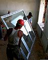 Mongolian Armed Forces engineers and contractors with Agudam LLC install a new window during a renovation project at Erdmiin Oyun School in the Nalaikh district of Ulaanbaatar, Mongolia, July 25, 2013, as part 130725-M-MG222-006.jpg