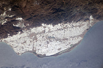 Human rights in Spain - NASA view of greenhouses at El Ejido on the Campo de Dalías, Spain.