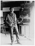 full length portrait of N.C. with his palette in his studio