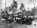 New Zealand's latest railway - Members of the 3rd, Auckland Regiment at Apia, Samoa, and the petrol engine and light railway formerly used by the Germans in carrying material for the construction of the wireless station.jpg