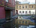 Nizhny Novgorod. April puddles near Children Club. (Ilyinskaya St., 68a).jpg