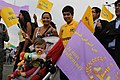 Non-Iranian rent-a-crowd woman and her children in PMOI rally.jpg