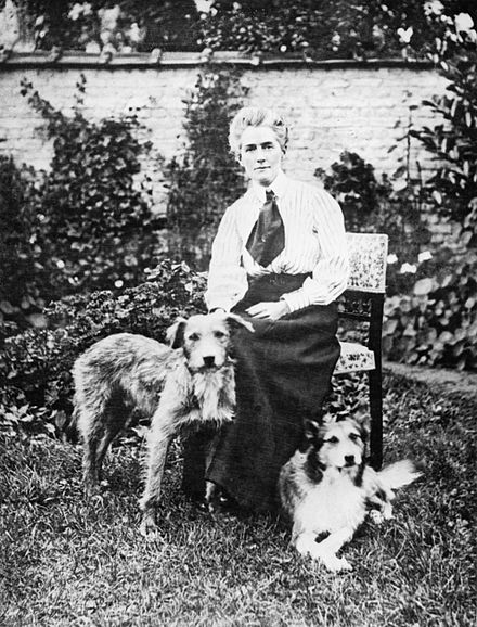 Cavell in a garden in Brussels with her two dogs before the outbreak of war Nurse Edith Cavell 1865-1915 Q32930.jpg