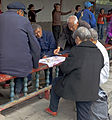 Old people playing cards at Temple of Heaven Park, Beijing.jpg