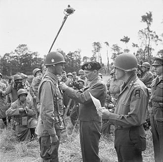 Maxwell D. Taylor - Taylor, pictured here on the left, receiving the Distinguished Service Order from General Sir Bernard Montgomery for gallantry in action at Carentan, France, June 12, 1944.