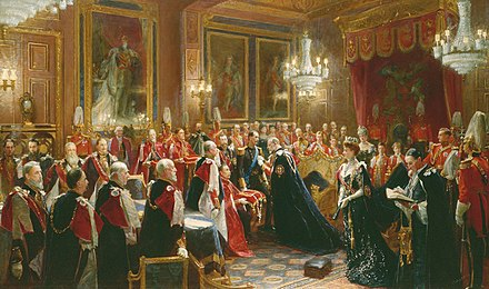 Edward VII invests Haakon VII of Norway with the insignia of the Order of the Garter in the Throne Room of Windsor Castle, November 1906. Painting by Sydney Prior Hall. Order of the Garter investiture of King Haakon VII of Norway, by Sydney Prior Hall.jpg