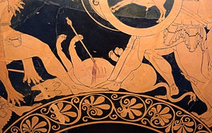 Orthrus - A two-headed Orthrus, with snake tail, lying wounded at the feet of Heracles (left) and the three-bodied Geryon (right). Detail from a red-figure kylix by Euphronios, 550–500 BC, Staatliche Antikensammlungen (Munich 2620).