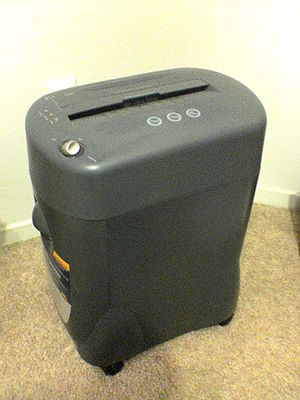 Paper shredder - Paper shredder with built-in wastebasket