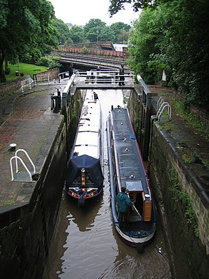 Chester Canal - Boats passing on the Northgate Staircase. The boat on the left is ascending the flight, and is moving from the bottom to the middle chamber. The boat on the right is descending.