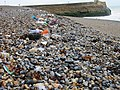 Pebble beach with rubbish washed onshore - geograph.org.uk - 485492.jpg