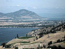 An aerial view of Penticton; Skaha Lake can be seen in the foreground, while Okanagan Lake is visible in the background. Penticton Regional Airport's runway can also be seen.