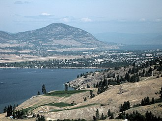 Penticton - An aerial view of Penticton; Skaha Lake can be seen in the foreground, while Okanagan Lake is visible in the background. Penticton Regional Airport's runway can also be seen.