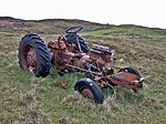 Photogenic tractor at Waternish, 5 km from Trumpan, Highland, Great Britain. Beyond this long-abandoned Zetor tractor, some of the boundary walls of the deserted Unish township can be seen.