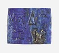 Plaque with Harpokrates (or similar) on a lotus, Ptah and Re-Harakhty(?) MET 30.8.692 view 2.jpg