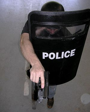 National Institute of Justice - Image: Police Officer with balistic shield